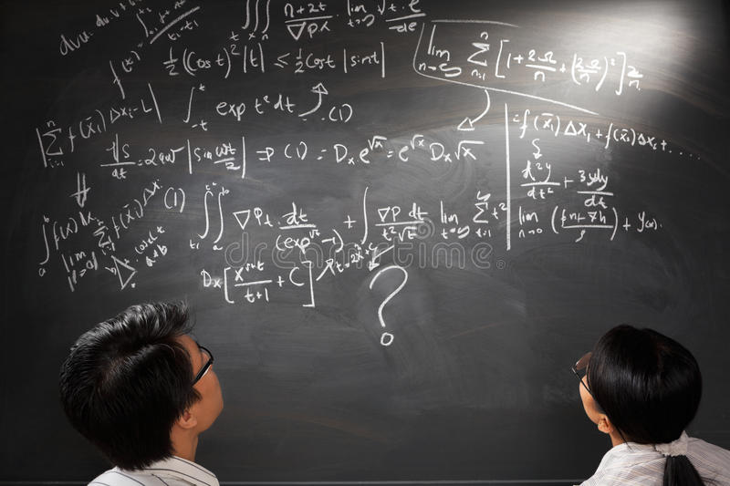 Looking at difficult complex equation stock photos