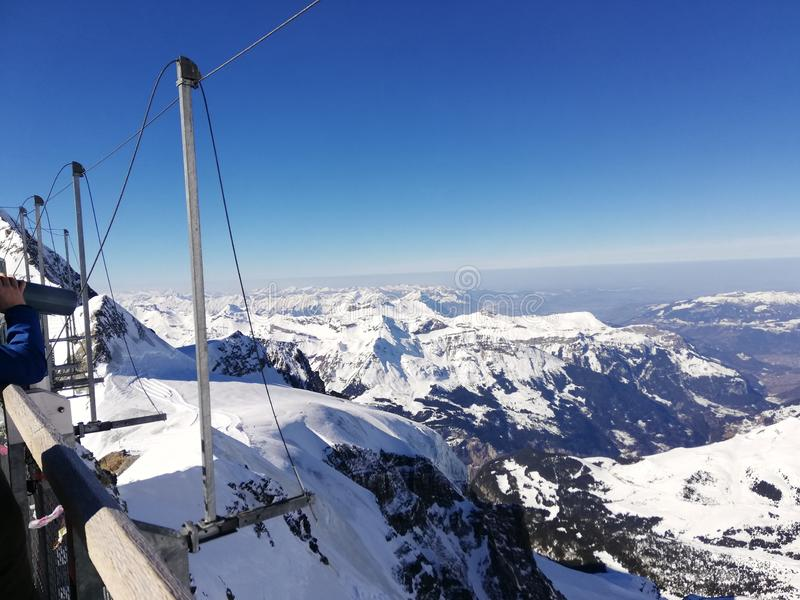 Looking down at the Alps from 3000+ meters in Switzerland. Looking down at the Alps from 3000+ meters in stock photography