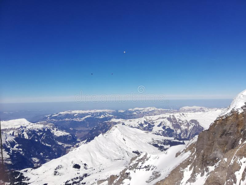 Looking down at the Alps from 3000+ meters in Switzerland. Looking down at the Alps from 3000+ meters in royalty free stock photos