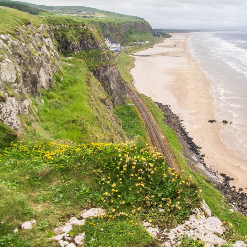 Looking down onto the beach from Dunluce Castle, Northern Ireland stock images