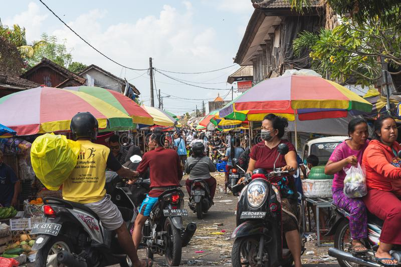 Looking down a busy lane with people on motorbikes and markets on the side of the lane July 22 2019 royalty free stock photo