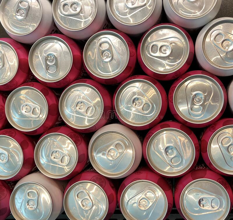 Looking down on cans of cola stock image