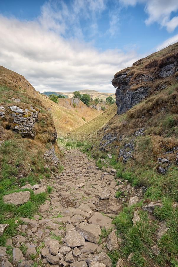 Looking down Cave Dale, Mam Tor in the background. Peak District, Derbyshire. The view down the rocky path of Cave Dale, sometimes known as Secret Valley, with royalty free stock photos