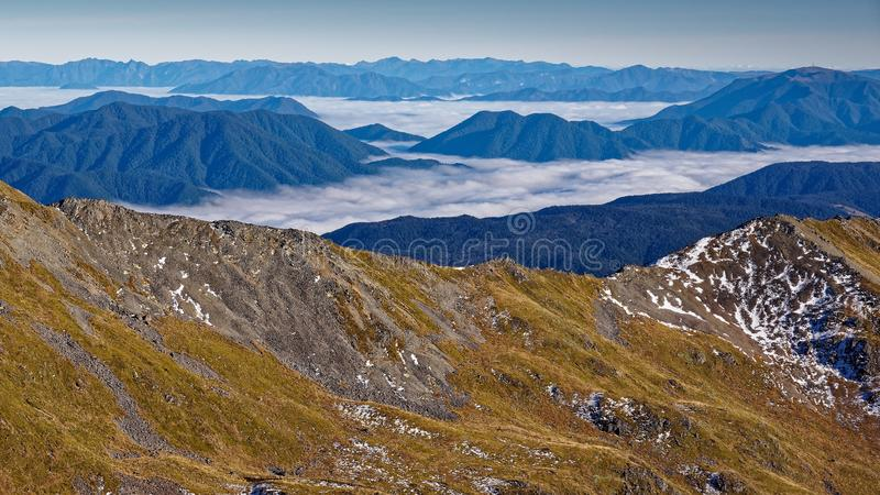 Cloud inversion. Looking down on clouds, Nelson Lakes National Park, New Zealand. On route from Angelus hut to St. Arnaud stock photos
