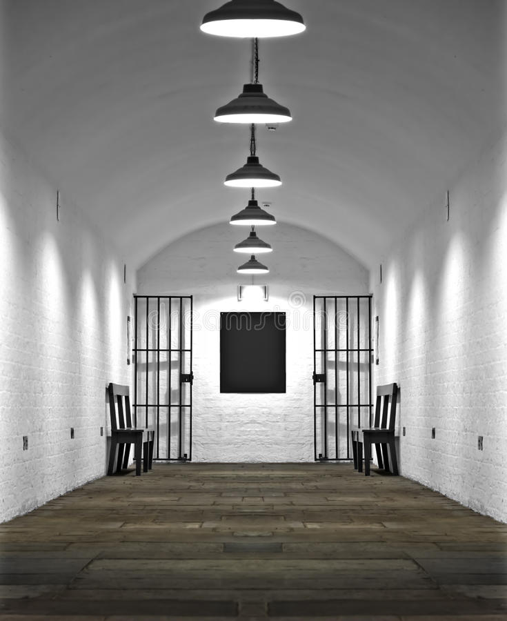 Old prison cell block. Looking down corridor in old prison cell block royalty free stock photography