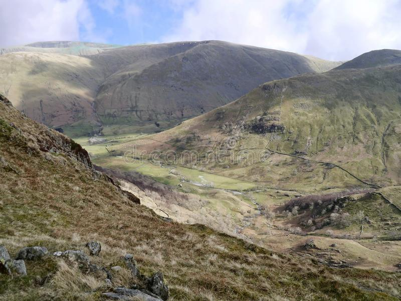 Looking down into Dovedale, Lake District. The fell in the background is Caudale Moor stock photography