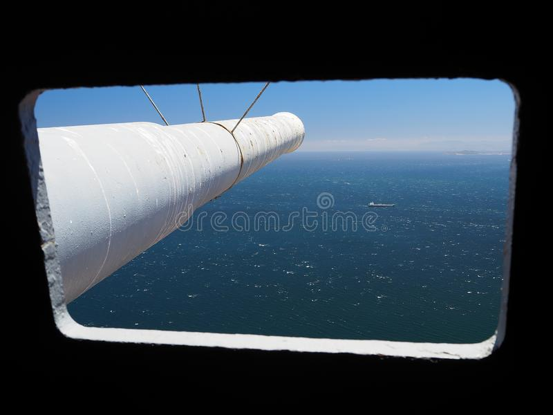 Looking out of sighting window down a gun barrel on Rock of Gibraltar stock images