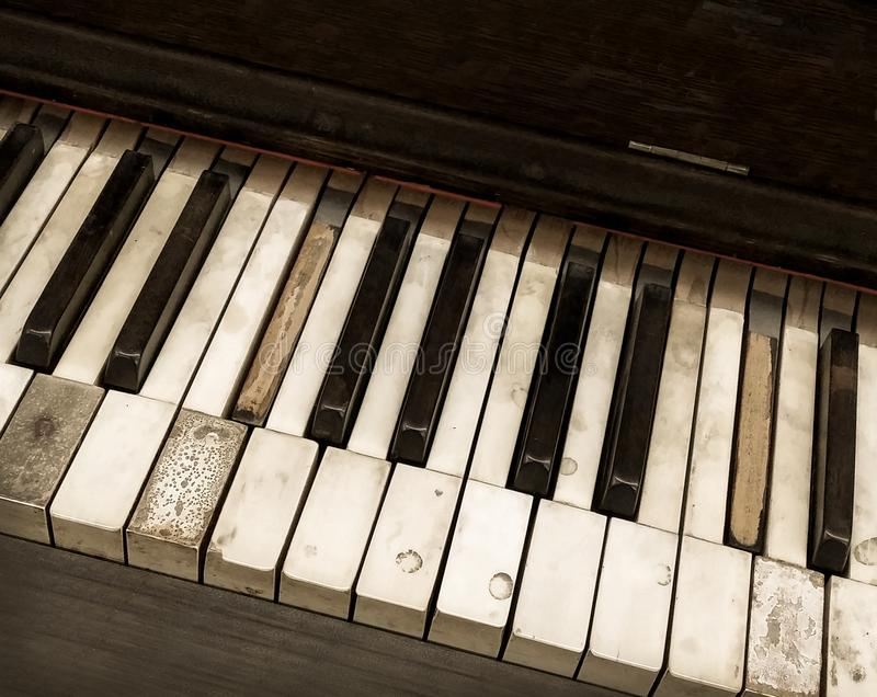 Looking down overhead view of old abandoned antique distressed piano keyboard close up stock photos