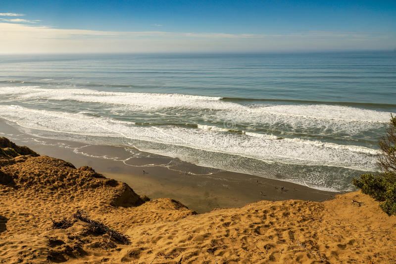 Looking down at the Pacific Ocean waves from a sandy cliff in Ca royalty free stock photo