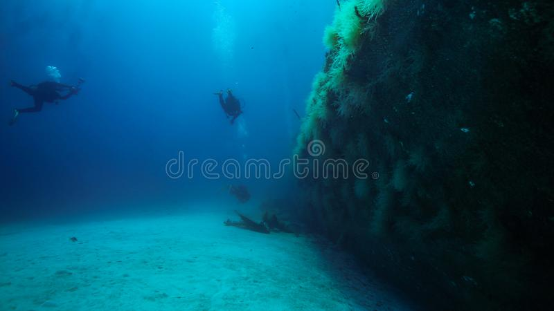 Looking down the Starboard side of the P31 an underwater photographer shoots images in the distance. Lying in the central Mediterranean of the coast of Malta is stock photo