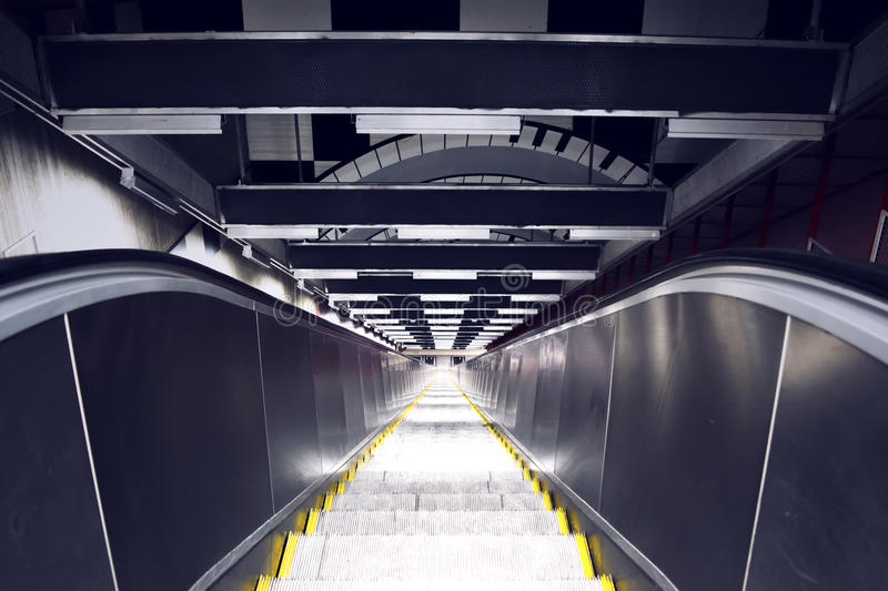 Looking down in steep escalator. In a subway station in Stockholm stock image