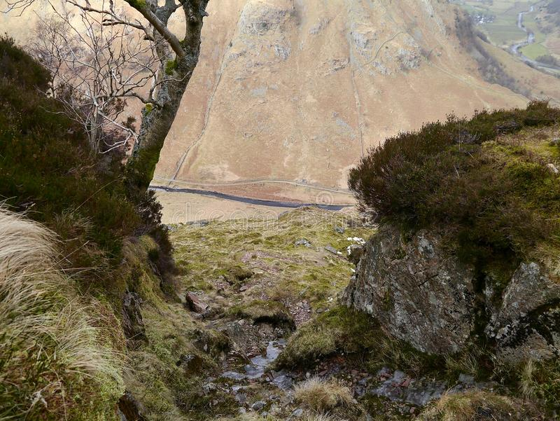 Looking down to Greenup gill. Langstrath beck viewed from an icy gulley by Eagle Crag near stonethwaite, Lake District stock photo