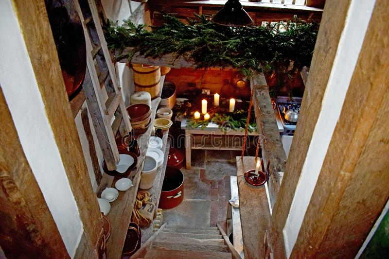 Looking down into a Tudor kitchen that is decorated for Christmas royalty free stock images