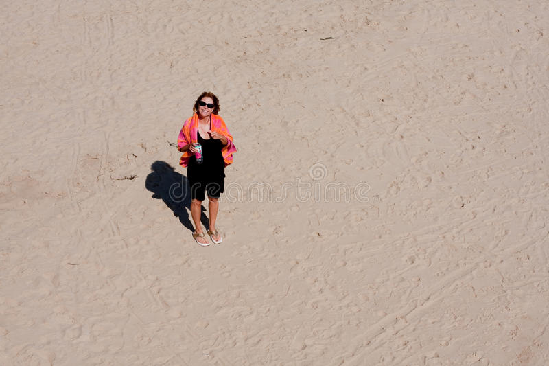 Looking Down At A Woman Standing In Sand Stock Photo
