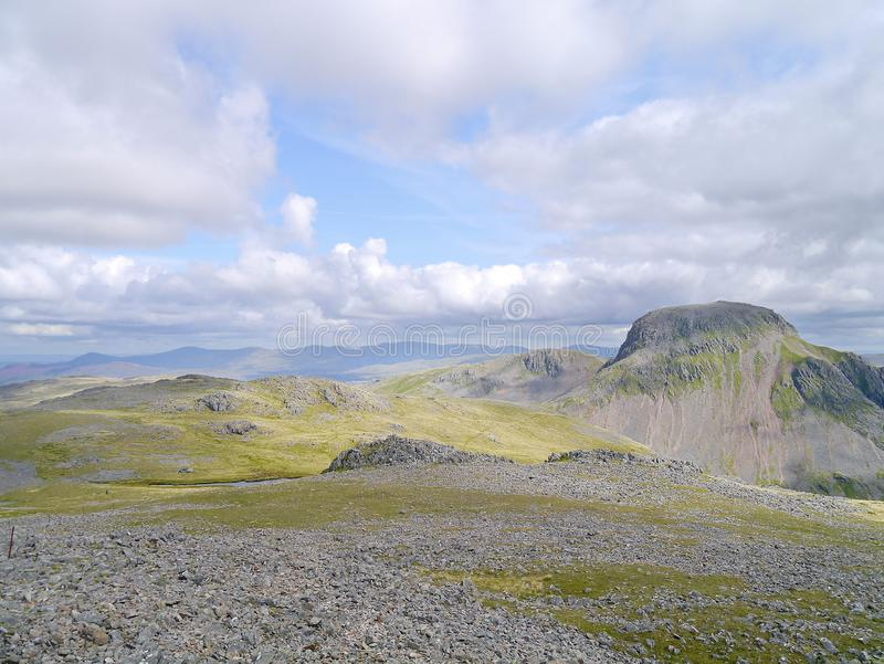 Looking eastwards from Kirk Fell summit, Lake District. Great Gable dominant centre right seen from Kirk Fell on a glorious day for walking royalty free stock photography