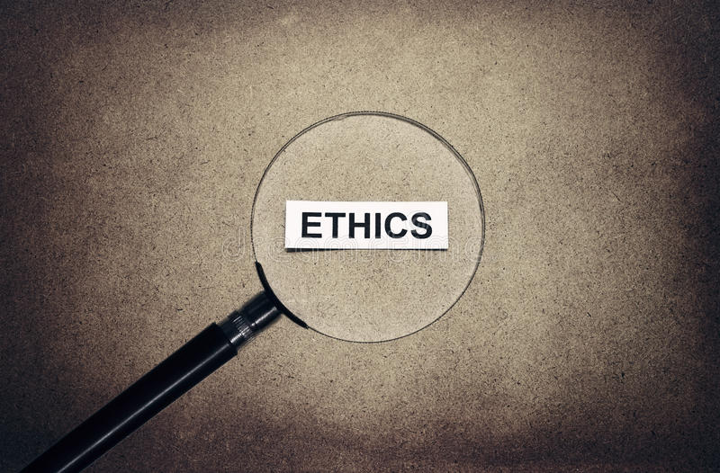 Looking ethics. Paper on retro background stock photos