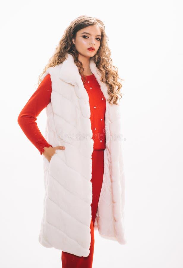 Looking expensive. Fashion model wear luxurious fur. Pretty woman in luxury fur vest. Winter fashion trend. Young woman. Wear elegant garment. Fashionable royalty free stock photo
