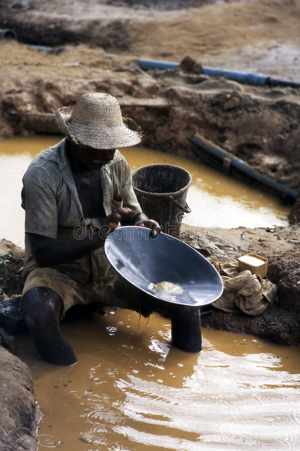 Looking for gold. A man looking for gold in a gold mine - in Brazil