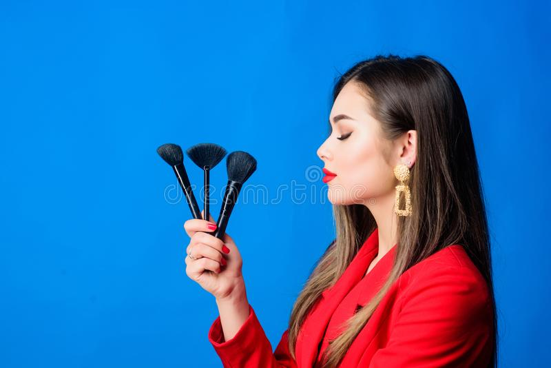 Looking good and feeling confident. Professional makeup supplies shop. Makeup courses. Gorgeous lady make up red lips stock photography