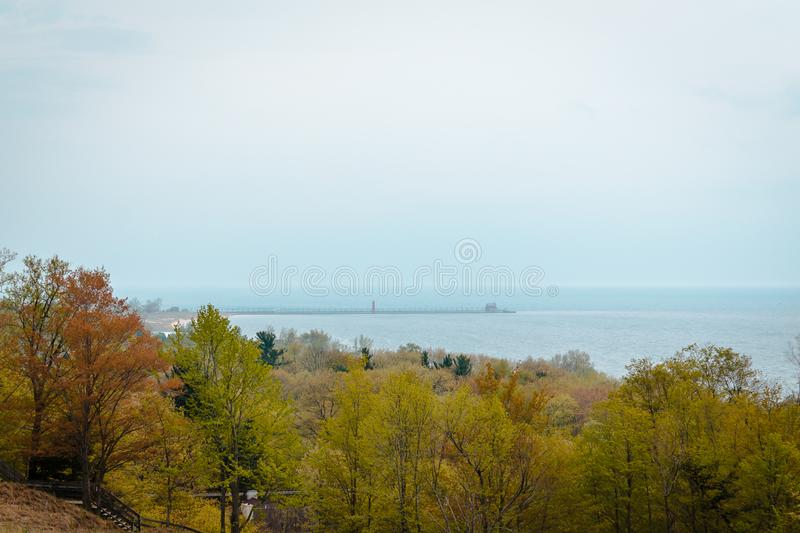 Looking at Grand Havens lighthouse off in the distance from Muskegon Michigan. On a summer day royalty free stock photos