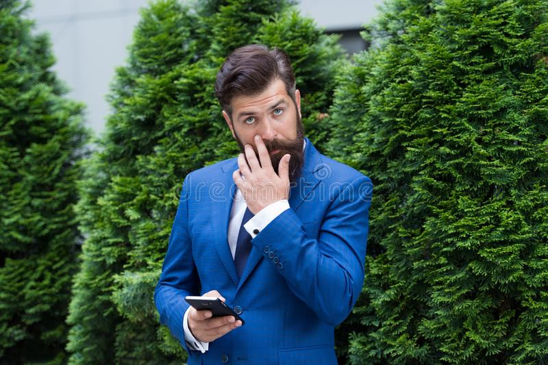 Looking great. agile business. bearded man on business meeting. using modern technology. modern look of ceo. responding royalty free stock photos