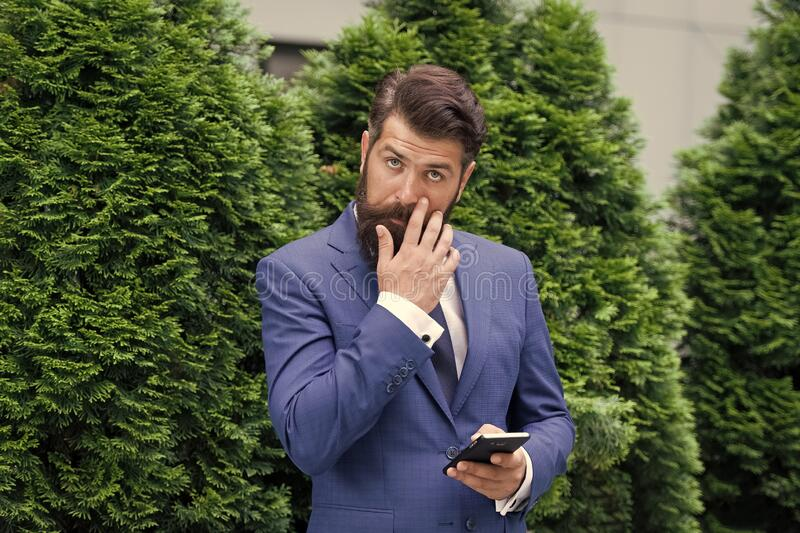 Looking great. agile business. bearded man on business meeting. using modern technology. modern look of ceo. responding stock photos