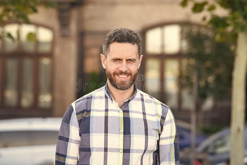 Looking great in that shirt. Mature man on urban background. Handsome mature adult in casual style. Mature person with royalty free stock photos