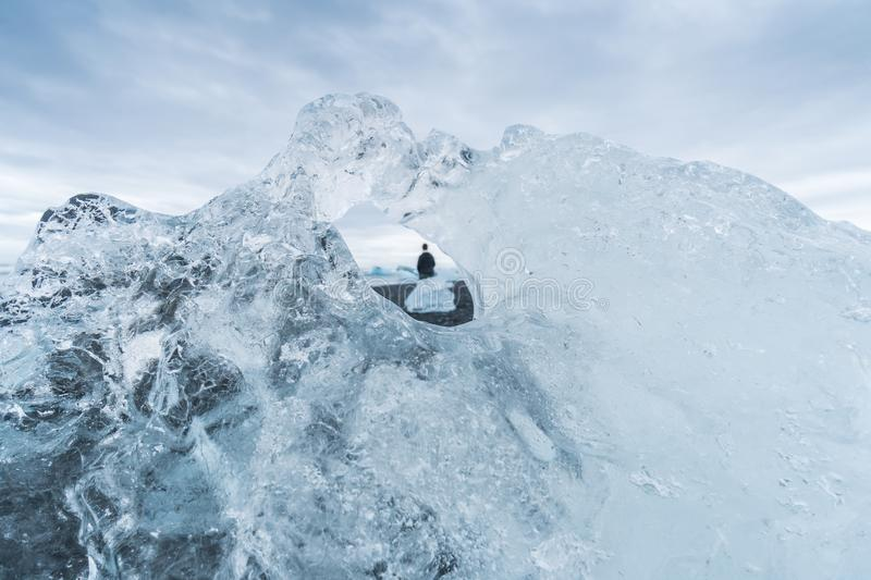 Looking Through a Hole in an Iceberg at Jokulsarlon, Iceland royalty free stock photo