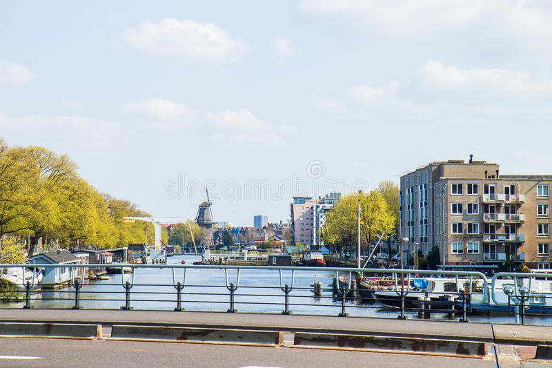 View upon Nieuwe Vaart and windmill The Gooyer, Amsterdam stock image