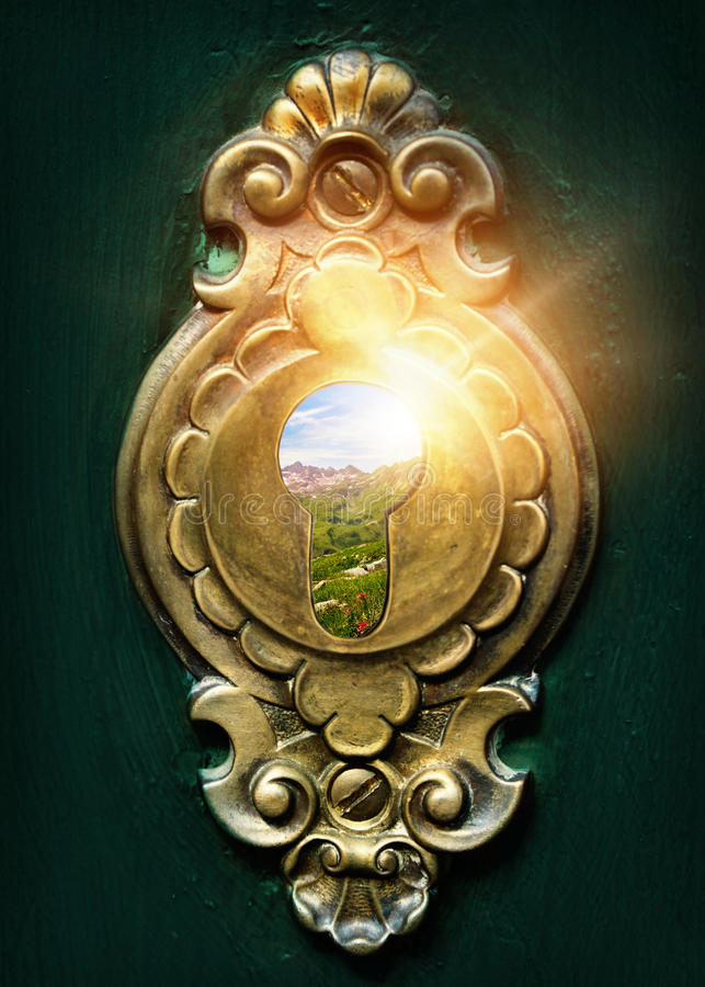 Looking through a keyhole stock image