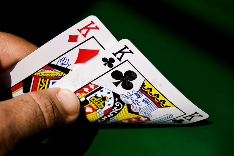 Looking at the kings. A pair of kings as pocket cards royalty free stock photo