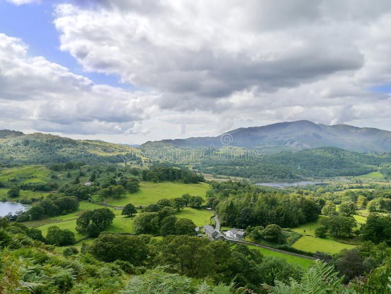 Looking from Loughrigg Fell, Lake District. From Loughrigg Fell, Loughrigg Tarn left, Elter Water right stock images