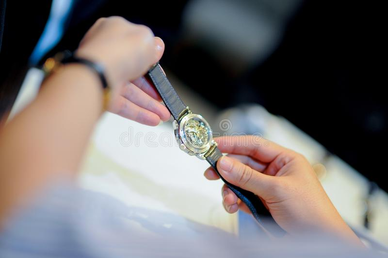 Looking on luxury watches. In hand stock images