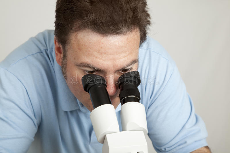 Download Looking Through Microscope stock photo. Image of experiment - 11373524