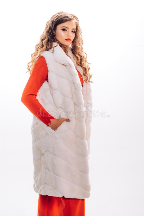 Looking more chic. Winter fashion trend. Pretty woman in luxury fur vest. Fashion model wear luxurious fur. Young woman. Wear elegant garment. Fashionable stock images