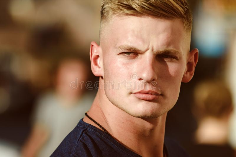 Looking more muscular. Handsome man with fashionable haircut. Handsome man wear casual fashion clothes. Muscular fashion royalty free stock image