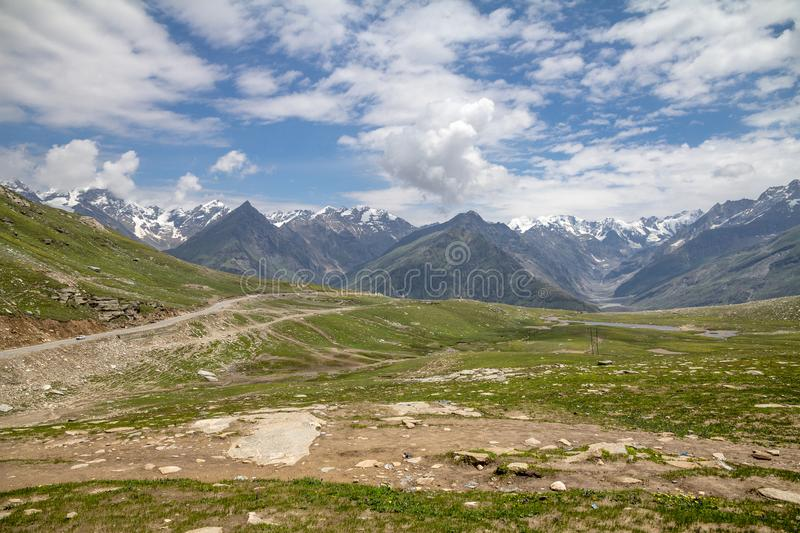 Rohtang Pass, Manali to Leh Highway, India. Looking north from Rohtang Pass in the Pir Pinjal range of the Himalayas, north of Manali on the road to Leh. The royalty free stock images