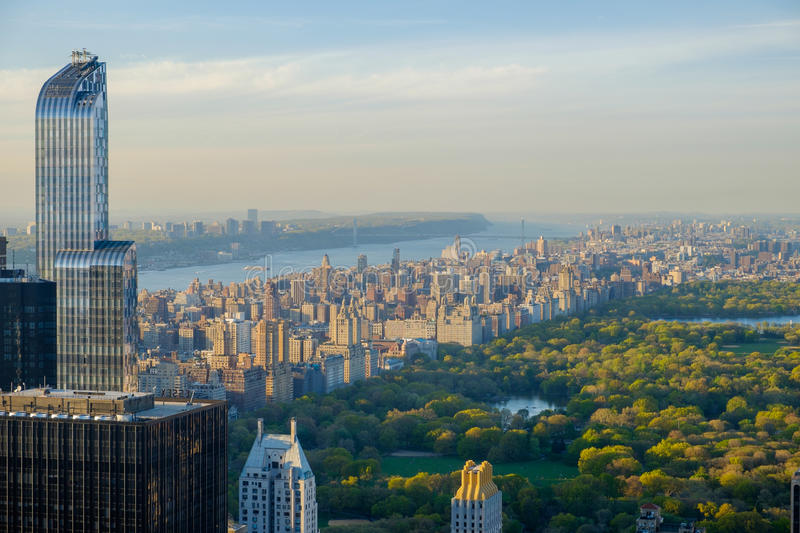 Looking North and west over Central Park at Dusk. Looking northwest towards Central Park and the George Washington Bridge and New Jersey off in the distance stock photography
