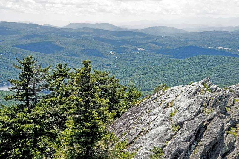 Swinging Bridge of Grandfather Mountain at a distance. Looking off the peak of Chimney Rock State Park stock image