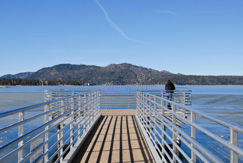 Download Looking Out stock image. Image of metal, mountains, pier - 22978855