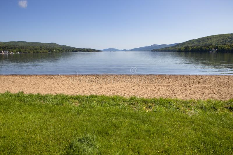 Looking out at Lake George in New York. The Dog Beach on the shores of Lake George in New York royalty free stock photo