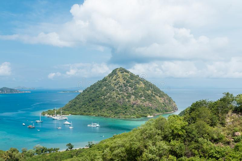 Looking out over the blue ocean and yachts from a hillside in Labuan Bajo, Flores, Indonesia. stock photos