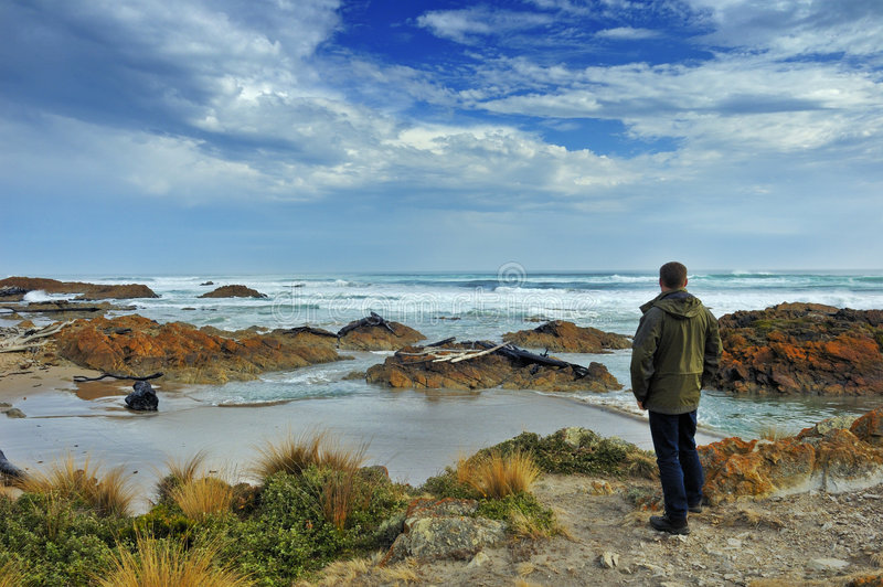 Download Looking out to sea. stock photo. Image of seashore, rough - 5552774