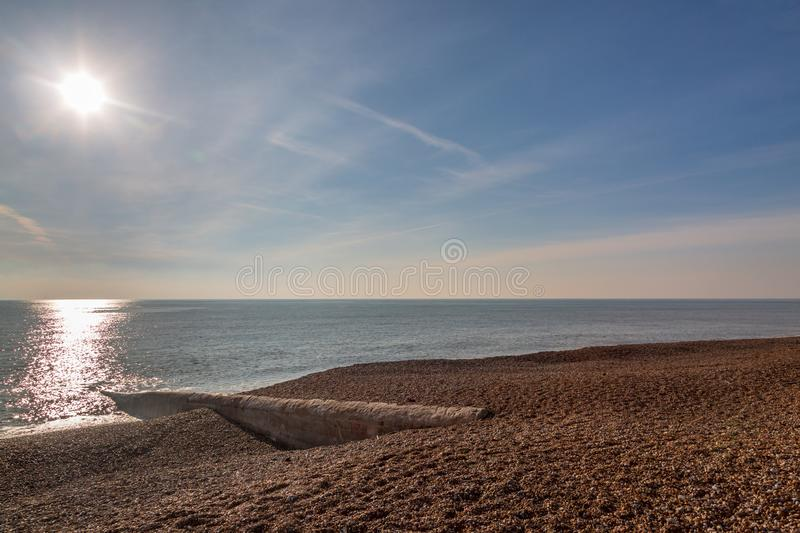 The Pebble Beach at Hove. Looking out to sea on a sunny winters day, at Hove Beach, Sussex stock image