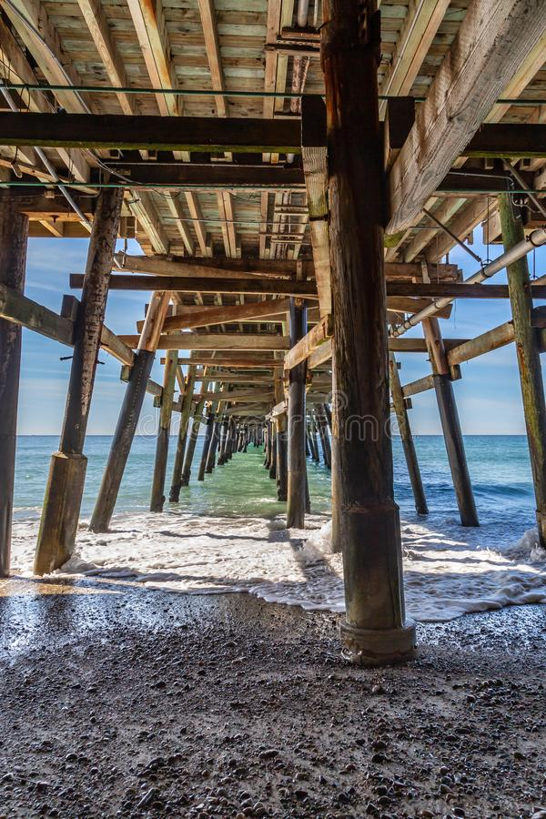 Coastal View from Under a Wooden Pier stock photos