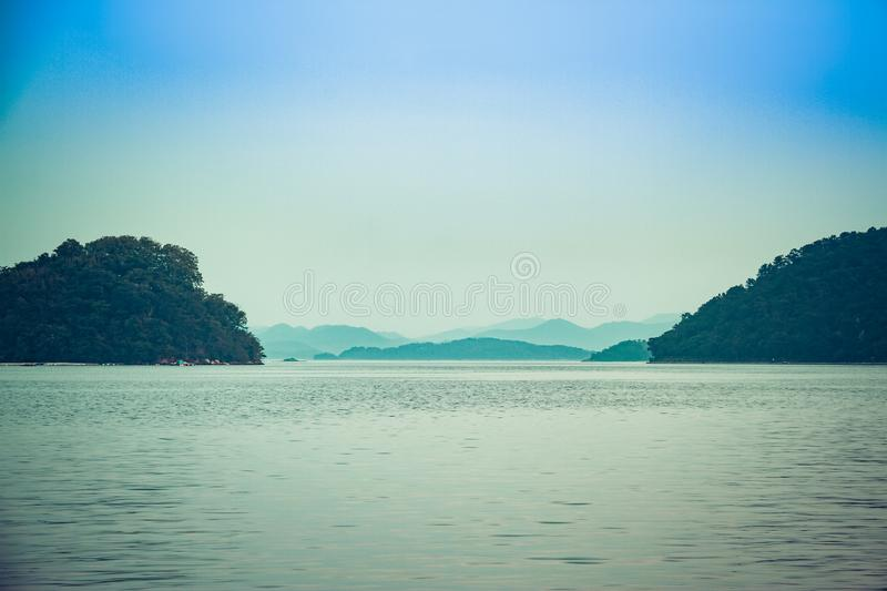Looking out to where the sea and mountains meet. Off the coast of South Korea royalty free stock images