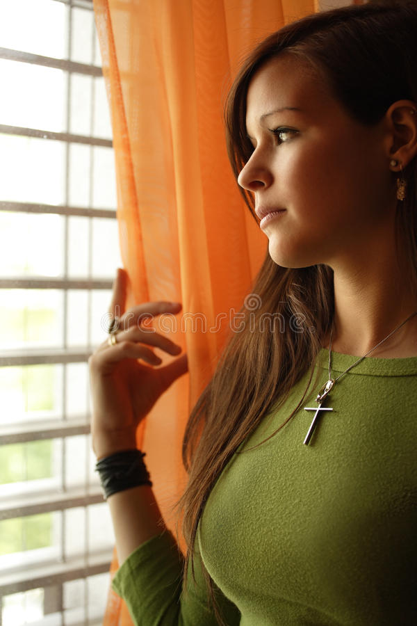 Download Looking out the window stock image. Image of brunette - 18601473