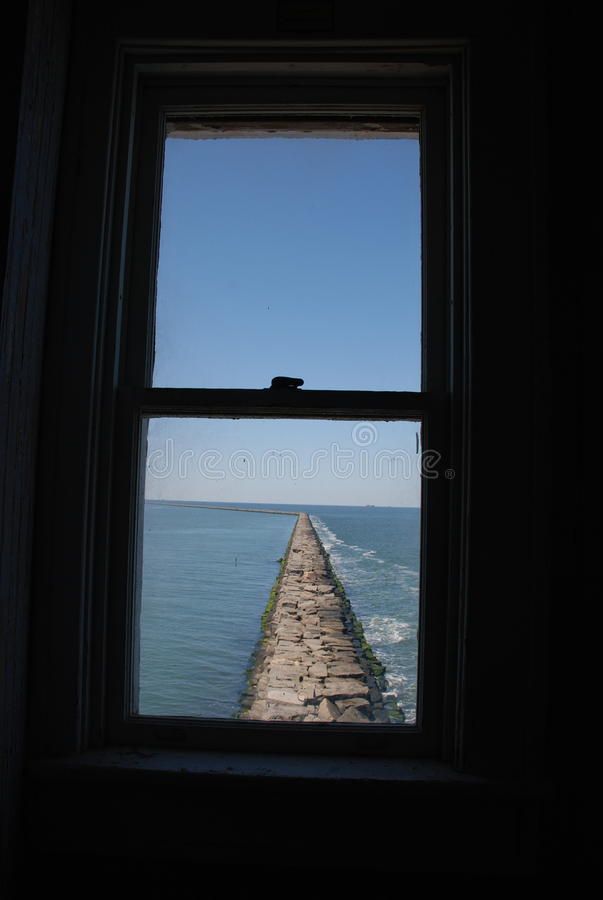 Looking out window of Harbor of Refuge Lighthouse, Lewes, Delaware. Looking out window towards Delaware bay, Harbor of Refuge Lighthouse Located in Lewes Beach stock photos