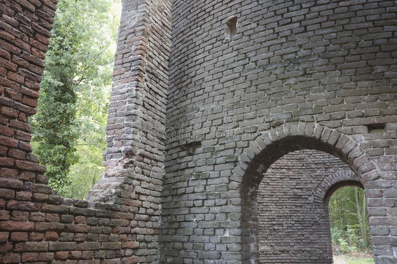 Looking outside from the inside of a ruin in the forest royalty free stock photography