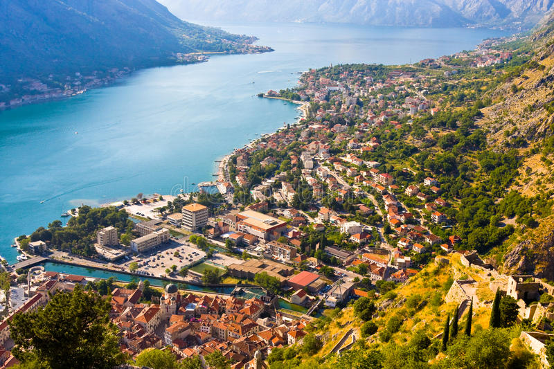 Looking over the Bay of Kotor in Montenegro with view of mountains, boats and old houses stock image